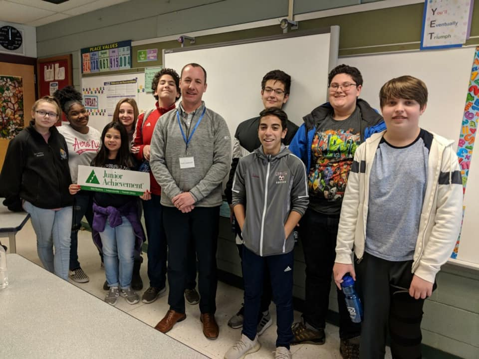 Peter poses with his 7th grade class at Paul R. Baird Middle School