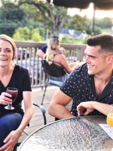 Andrea shares a drink and a smile with her twin brother, Josh